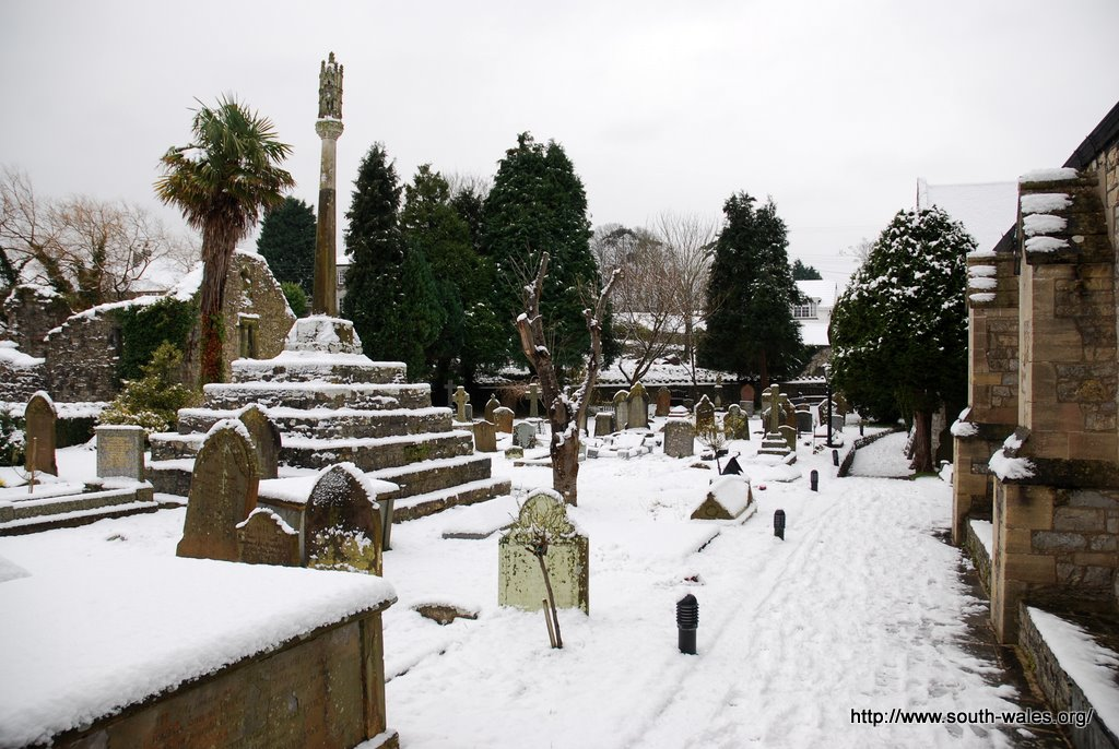 View of the southern graveyard and stone cross covered in snow
