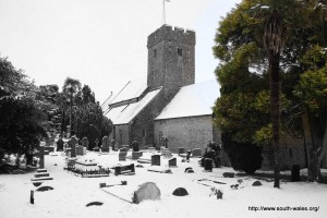 View of St Illtud's church with a snow covered graveyard