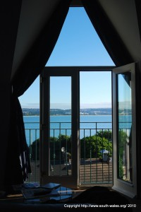 View of Swansea Bay through open door from room in Patricks